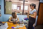 28 MARCH 2013 - BANGKOK, THAILAND:  Suzy Triplett (left) and Michelle Kao in the Thai Peace Foundation office.    PHOTO BY JACK KURTZ