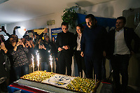 LUGO, ITALY - 5 JANUARY 2020: Matteo Salvini, former Interior Minister of Italy and leader of the far-right League party, looks at a cake with the party sign at a dinner in Lugo, Italy, on January 5th 2020.<br /> <br /> Matteo Salvini is campaigning in the region of Emilia Romagna to support the League candidate Lucia Borgonzoni running for governor.<br /> <br /> After being ousted from government in September 2019, Matteo Salvini has made it a priority to campaign in all the Italian regions undergoing regional elections to demonstrate that, in power or not, he still commands considerable support.<br /> <br /> The January 26th regional elections in Emilia Romagna, traditionally the home of the Italian left, has been targeted by Matteo Salvini as a catalyst for bringing down the government. A loss for the center-left Democratic Party (PD) against Mr Salvini's right would strip the centre-left party of control of its symbolic heartland, and probably trigger a crisis in its coalition with the Five Star Movement.