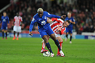 Arouna Kone of Everton holds off Stoke city's Phil Bardsley. Barclays Premier League match, Stoke city v Everton at the Britannia Stadium in Stoke on Trent , Staffs on Wed 4th March 2015.<br /> pic by Andrew Orchard, Andrew Orchard sports photography.