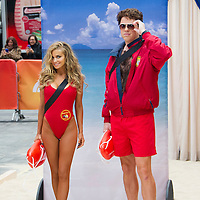 """Carmen Electra as Lani McKenzie and Willie Geist as Mitch Buchannon from the hit '90s show """"Baywatch"""" during the Annual Halloween Episode of NBC's The Today Show in New York City."""