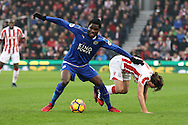 Daniel Amartey of Leicester City holds off Joe Allen of Stoke City. Premier league match, Stoke City v Leicester City at the Bet365 Stadium in Stoke on Trent, Staffs on Saturday 17th December 2016.<br /> pic by Chris Stading, Andrew Orchard sports photography.