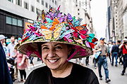 New York, NY - April 16, 2017. A woman wears a hat covered in brightly colored butterflies  at New York's annual Easter Bonnet Parade and Festival on Fifth Avenue.