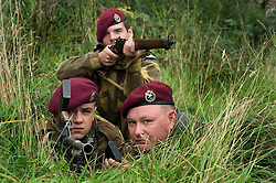 Re-enactors portray members of the 22nd Independent Parachute Company armed with the Lee Enfield Rifle and Bren light machine gun. Note the cap badge is Army Air Corps and not the usual Kings Crown Parachute Regiment Cap Badge which the company would have worn later in the war...29th and 30th Aug 2010 .Images © Paul David Drabble..