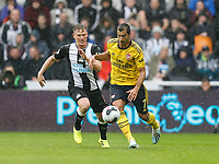 Football - 2019 / 2020 Premier League - Newcastle United vs. Arsenal<br /> <br /> Henrikh Mkhitaryan of Arsenal vies with Matt Ritchie of Newcastle United, at St James' Park.<br /> <br /> COLORSPORT/BRUCE WHITE
