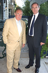 Left to right, ANDREW NEIL and GEOFF HOON MP at a party hosted by Andrew neil and The Business Newspaper held at The Ritz, Piccadilly, London on 12th July 2005.<br /><br />NON EXCLUSIVE - WORLD RIGHTS