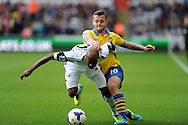 Swansea city's Dwight Tiendalli holds off Arsenal's Jack Wilshere. Barclays Premier league, Swansea city v Arsenal at the Liberty Stadium in Swansea on Saturday 28th Sept 2013.  pic by Andrew Orchard, Andrew Orchard sports photography.