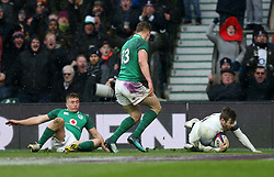 England's Elliot Daly scores his side's second try of the game during the NatWest 6 Nations match at Twickenham Stadium, London.