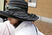 Asian woman wearing a large fashionable hat
