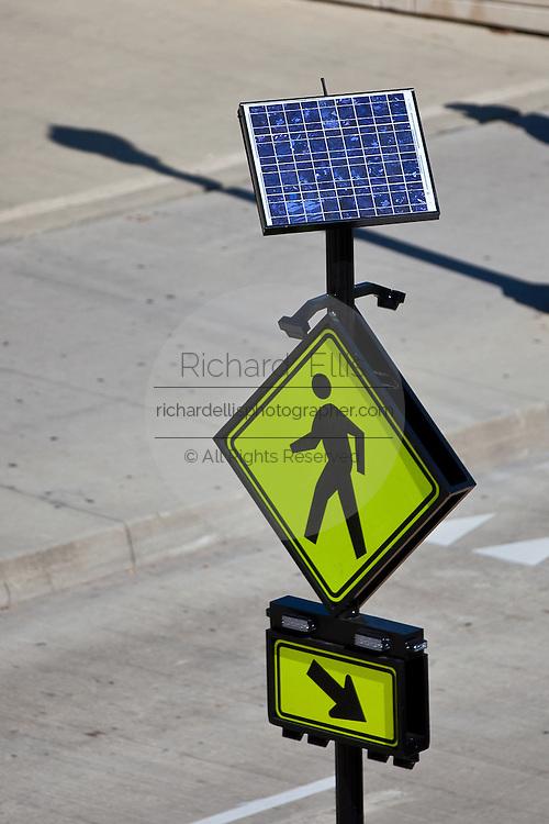 Solar powered pedestrian walk sign on Monroe Street in Chicago, IL, USA.