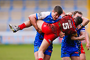 Halifax RLFC interchange James Green () tackles London Broncos winger Kieran Dixon (5)  during the Betfred Championship match between Halifax RLFC and London Broncos at the MBi Shay Stadium, Halifax, United Kingdom on 8 April 2018. Picture by Simon Davies.