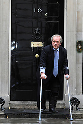 © Licensed to London News Pictures. 22/02/2012, London, UK. Gordon Taylor of the Professional Footballers Association leaves Downing Street after the summit. Mr Taylor is on crutches after slipping on ice and tearing a tendon earlier in the year. British Prime Minister David Cameron holds an anti-discrimination summit with former players and football bosses at Downing Street, central London. Photo credit : Stephen Simpson/LNP