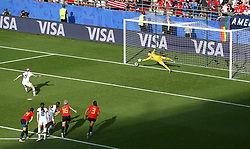 USA's Megan Rapinoe (left) scores her side's second goal of the game from the penalty spot