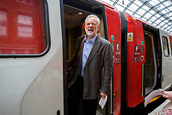 **FILE PICTURE - Monday December 21 marks 100 days since Jeremy Corbyn became leader of the Labour Party**© Licensed to London News Pictures. 18/08/2015. London, UK. Labour Party leader candidate JEREMY CORBYN traveling to Middlesbrough via a Virgin train after outlining his plans for integrated publicly owned railway network at King's Cross station in London on Tuesday, August 18, 2015. Photo credit: Tolga Akmen/LNP