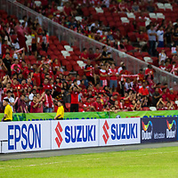 Shaiful Esah (#3) of Singapore shows his appreciation to Singapore fans after the 1-3 loss against Malaysia during the group stage match of the AFF Suzuki Cup at the National Stadium at the Singapore Sports Hub on November 29, 2014, in Singapore.