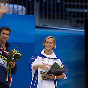 Swimmers of the meet Michael Phelps of USA and Federica Pellegrini of Italy on the podium at the World Swimming Championships in Rome, Italy on Sunday, August 2, 2009. Photo Tim Clayton..