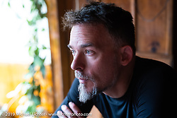 Devil Chicken artist Chris Galley on Motorcycle Sherpa's Ride to the Heavens motorcycle adventure in the Himalayas of Nepal. On the fourth day of riding, we went from Kalopani to Muktinath. Thursday, November 7, 2019. Photography ©2019 Michael Lichter.