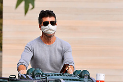 Simon Cowell wears a mask grocery shopping at Whole Foods in Malibu during COVID-19 virus pandemic lockdown in California. 05 Apr 2020 Pictured: Simon Cowell. Photo credit: Rachpoot/MEGA TheMegaAgency.com +1 888 505 6342