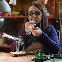 VENICE, ITALY - DECEMBER 18:  Elena Rosso a glass  artist in Murano blows a Christmas bauble using a table burner on December 18, 2010 in Venice, Italy. There are only few female glass artists is Italy and they face continuous challanges in a traditionally male dominated field.