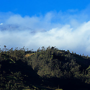 The summit of mighty Tungurahua peeks out of the fog for a moment.
