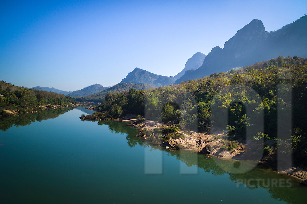 Serene landscape of Nam Ou River and surrounding mountains, north of Luang Prabang, Laos, Southeast Asia