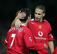 Photo: Lee Earle.<br /> Portsmouth v Manchester United. The Barclays Premiership. 11/02/2006. United's Rio Ferdinand (R) congratulates Cristiano Ronaldo after he scored their third.