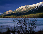 The Cassiar Mountains illuminated during a spring storm north of Good Hope Lake, northern British Columbia, Canada.