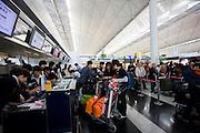 Passengers at check-in desks, Hong Kong International Airport, China