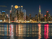The New Yorker, A Wyndham Hotel, an Art Deco-inspired hotel, The Empire State Building, and Manhattan modern building complex define the skyline of New York City.
