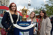 three Office ladies pose next to the Webb Ellis Trophy. RWC 2015, Coca Cola London Eye launch for the Rugby World cup event  in London on Tuesday 15th Sept  2015.<br /> pic by John Patrick Fletcher, Andrew Orchard sports photography.