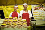 Local food stall, with two 2 young Cuban men at it, in aprons selling burgers. Cuban locals attend a Rodeo in Ciego de Avila province, Cuba.