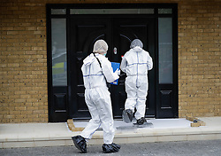 © London News Pictures. 21/05/2016. Weybridge, UK. Police forensics at the front door of a property at St George's Hill, Weybridge, Surrey where the body of a woman in her 30's was discovered by paramedics this morning (Sat). Photo credit: Peter Macdiarmid/LNP