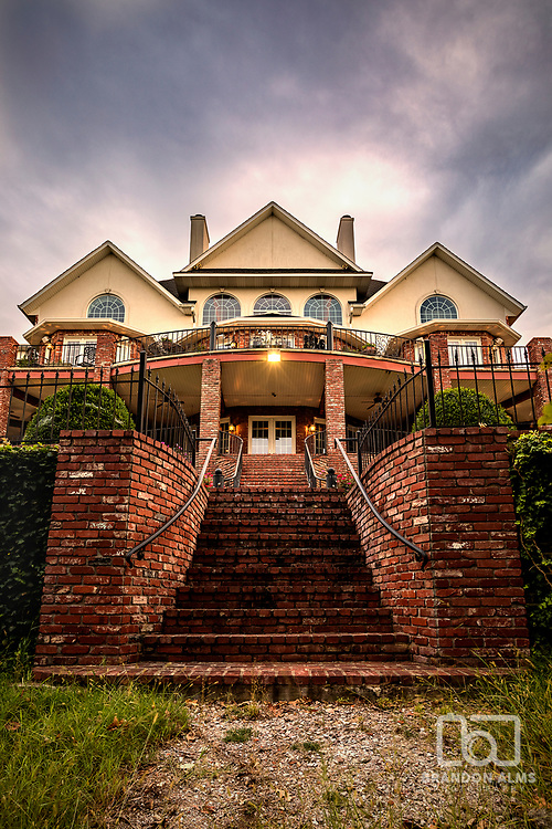 Large house that is a lake front property. Photo by Brandon Alms Photography