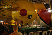 Poke Mon Balloon at The Macy's Balloon Inflation session held at West 79th and Central Park West on November 26, 2008 in New York City..A tradition since 1927, the giant character balloons are slowly blown up and brought to life in the streets around the American Museum of Natural History. The enormous balloons take up two full city blocks. Nets and sandbags are used to keep the balloons from escaping during the night.