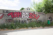 Colorful graffiti of city name on wall at the edge of a Polish town. Tomaszow Mazowiecki Central Poland