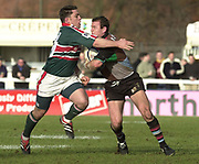 Twickenham, Surrey, UK., 19.01.2002, Tigers Rod Kafer, get's to grips with, Quin's Nick Burrows, during the, Harlequins vs Leicester Tigers Powergen National Cup Rugby match, played at the, Stoop Memorial Ground, [Mandatory Credit: Peter Spurrier/Intersport Images],