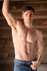 shirtless muscular man in a cabin