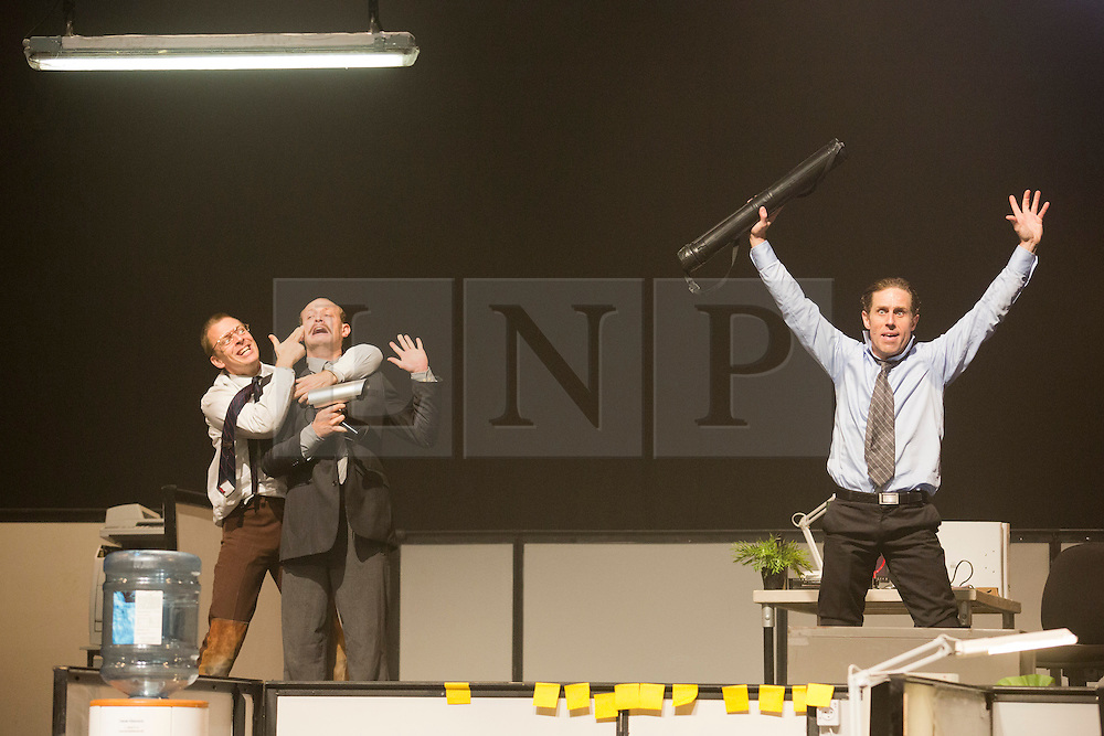 © Licensed to London News Pictures. 23/10/2013. London, England. The show BLAM! - where Die Hard meets The Office - opens at the Peacock Theatre, 22 October to 16 November 2013. In an attempt to escape their painfully dull 9-to-5 jobs, four ingenious office workers invent BLAM! an imaginary physical game and the mundane workplace is transformed into a world populated by aliens, superheroes and classic blockbuster movie villains. Performers: Kristján Ingimarsson (also director), Didier Oberle, Janus Elsig and Lars GRegersen. Photo credit: Bettina Strenske/LNP