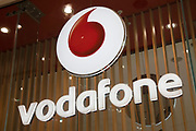 Sign for the mobile phone and telephone service provider brand Vodafone in Birmingham, United Kingdom.