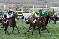 National Hunt Horse Racing - 2020 Cheltenham Festival - Wednesday, Day Two (Ladies Day)<br /> <br /> Winner, Mark Walsh on Aramax approaches the finish line ahead of Jonathan Moore on Theatre of War in the 16.50 Boodles Juvenile Handicap Hurdle race (Grade 3), at Cheltenham Racecourse.<br /> <br /> CREDIT : COLORSPORT / ANDREW COWIE