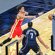 ORLANDO, FL - MARCH 03: Trae Young #11 of the Atlanta Hawks makes a pass in front of Michael Carter-Williams #7 of the Orlando Magic during the second half at Amway Center on March 3, 2021 in Orlando, Florida. NOTE TO USER: User expressly acknowledges and agrees that, by downloading and or using this photograph, User is consenting to the terms and conditions of the Getty Images License Agreement. (Photo by Alex Menendez/Getty Images)*** Local Caption *** Trae Young; Michael Carter-Williams
