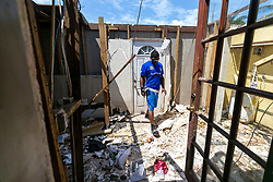 Ronnie Saunders, 42, a machine operator at Freeport Harbor, surveys the wreckage done by Hurricane Dorian to his Royal Manners house on Friday, September 6, 2019. Saunders lives with his fiancee and 18-year-old daughter. Photo by Matias J. Ocner/Miami Herald/TNS/ABACAPRESS.COM