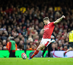 Dan Biggar of Wales kicks a penalty<br /> <br /> Photographer Simon King/Replay Images<br /> <br /> Six Nations Round 1 - Wales v Italy - Saturday 1st February 2020 - Principality Stadium - Cardiff<br /> <br /> World Copyright © Replay Images . All rights reserved. info@replayimages.co.uk - http://replayimages.co.uk
