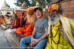 Jonathan Pity with Shaiva Sadhus (Hindu holy men and followers of Shiva) at Pashupatinath Temple, a sacred Hindu temple complex on the banks of the Bagmati River near Kathmandu during our Himalayan Heroes adventure, Nepal. Saturday, November 3, 2018. Photography ©2018 Michael Lichter.