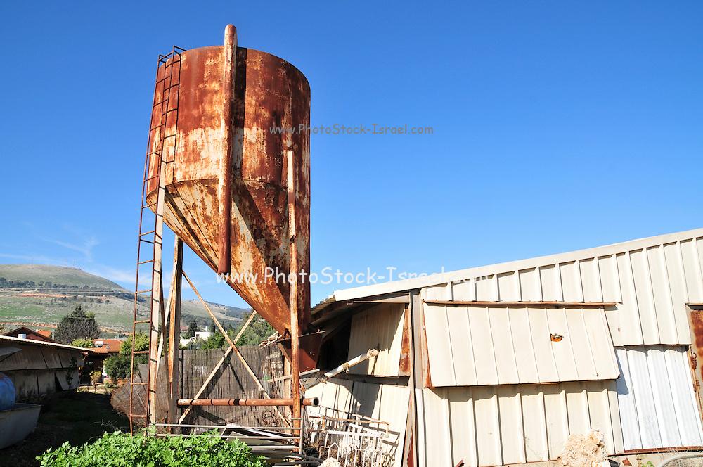 Israel, Galilee, a chicken coop with feeding silo on a Moshav