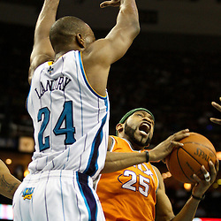 April 8, 2011; New Orleans, LA, USA; Phoenix Suns shooting guard Vince Carter (25) is defended by New Orleans Hornets power forward Carl Landry (24) during the third quarter at the New Orleans Arena. The Hornets defeated the Suns 109-97.   Mandatory Credit: Derick E. Hingle