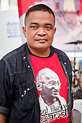 """17 MAY 2010 - BANGKOK, THAILAND: JUTAPORN PROMPAN, a Red Shirt core leader, just before he announced to the Red Shirts that their unofficial military commander """"Seh Daeng"""" had died. The Thai government announced Monday that the Red Shirts unofficial military commander and renegade Thai Army Maj. Gen. KHATTIYA """"Seh Daeng"""" SAWASDIPOL, died Monday from wounds he suffered when a sniper shot him in the head on May 12 while he was being interviewed by an American reporter. When the announcement was read to the Red Shirt protesters still camped out in Ratchaprasong intersection in Bangkok many started weeping.   PHOTO BY JACK KURTZ"""