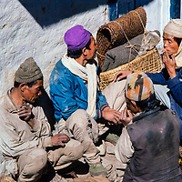 Lowland farmers relax after selling their wares at  the Khumbu region of Nepal 1986.