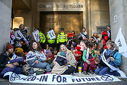 © Licensed to London News Pictures. 02/12/2019. London, UK. Mothers from climate change campaign group, Extinction Rebellion, stage a breast-feeding protest outside Brexit Party headquarters in Westminster, ahead of the UK General Election. The campaigners are demanding action on behalf of babies and children affected by the climate and ecological emergency. It is the first event of a wider Extinction Rebellion pre-Christmas protests, '12 Days of Crisis'. Photo credit: Dinendra Haria/LNP
