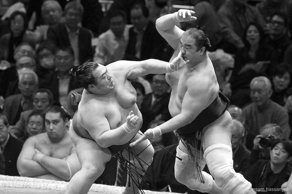 Sumo wrestlers compete at the Ryōgoku Kokugikan in Tokyo during the grand tournament.