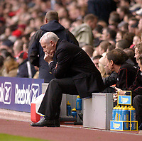 Photo. Glyn Thomas.<br /> Liverpool v Leeds Utd. Barclaycard Premiership.<br /> Anfield, Liverpool. 25/10/03.<br /> Leeds manager Peter Reid looks pensive as his side loses 3-1.
